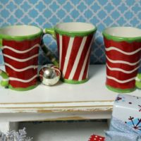 Red and Lime Green Christmas Mugs By Carolina Pantry