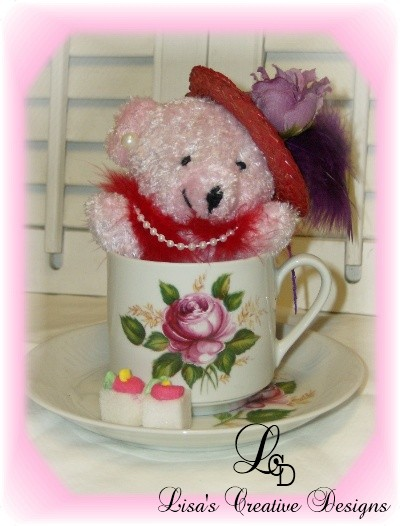 red hat lady teddy bear tea cup