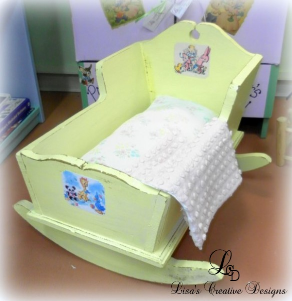 yellow vintage doll cradle
