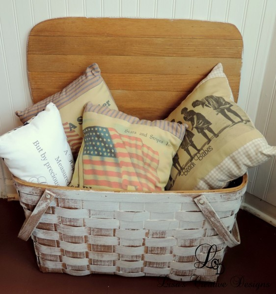 Vintage Picnic Basket Displaying An Assortment Of Pillows