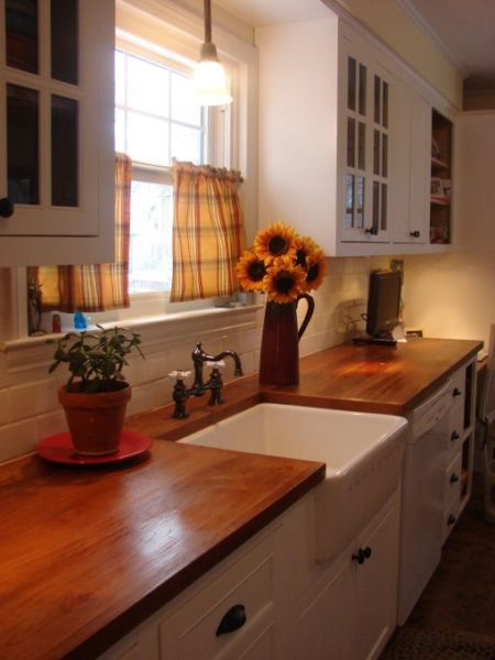 Sunflowers In A Country Kitchen