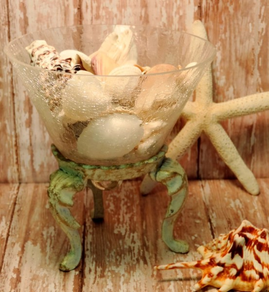 Seashell Filled Glass Container On Metal Stand